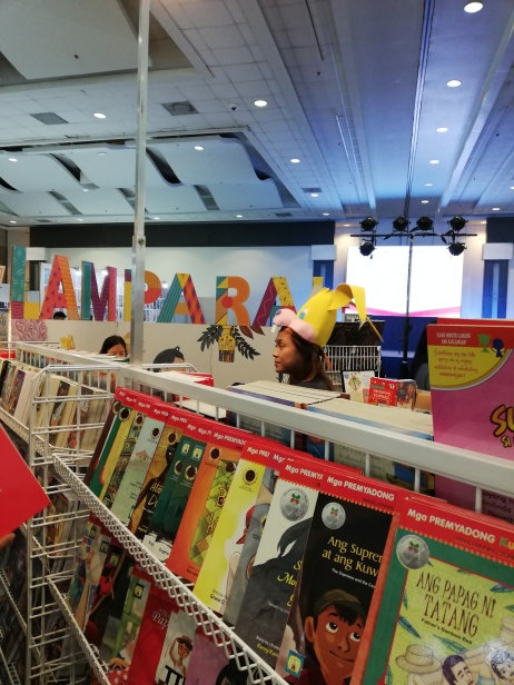 Colorful and well-stocked booth by Lampara